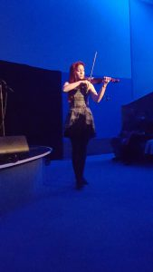 Elsa Jean McTaggart wows the crowd with her original celtic composition 'Lig Osna' on the electric violin